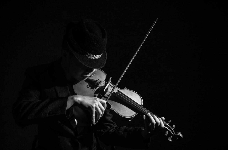 Close up Violin player in dark studio, Musical concept